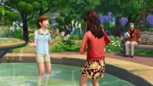 Дети плескаются в фонтане в Романтическом саду