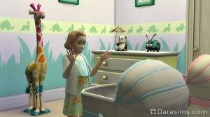 Школьница развлекает малыша в люльке
