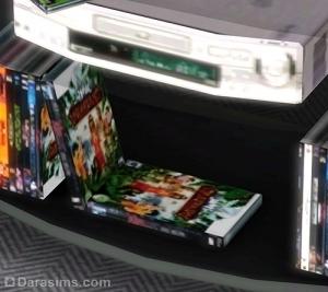 Диски с играми под телевизором