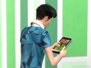 игра на планшете в The Sims 4