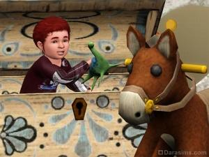 Малыш играет в ящике с игрушками в Симс 3