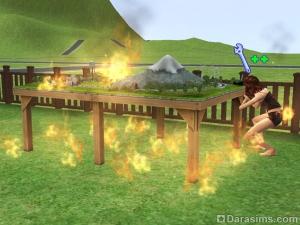 Игрушечная модель поезда горит в огне
